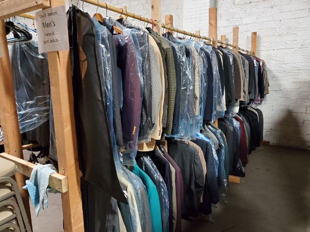 Section 7 of VSC & HRH's warehouse - Men's suits from the Men's Warehouse