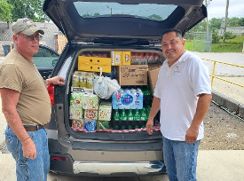 Charlie helping Carlos' ministry with a load of drinks and non-perishable food items